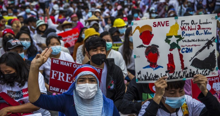 "People protest the recent military coup, in Yangon, Myanmar on Monday, Feb. 22, 2021. The three-finger sign, a widely-used sign of civil disobedience is adapted from ""The Hunger Games."" (The New York Times)"